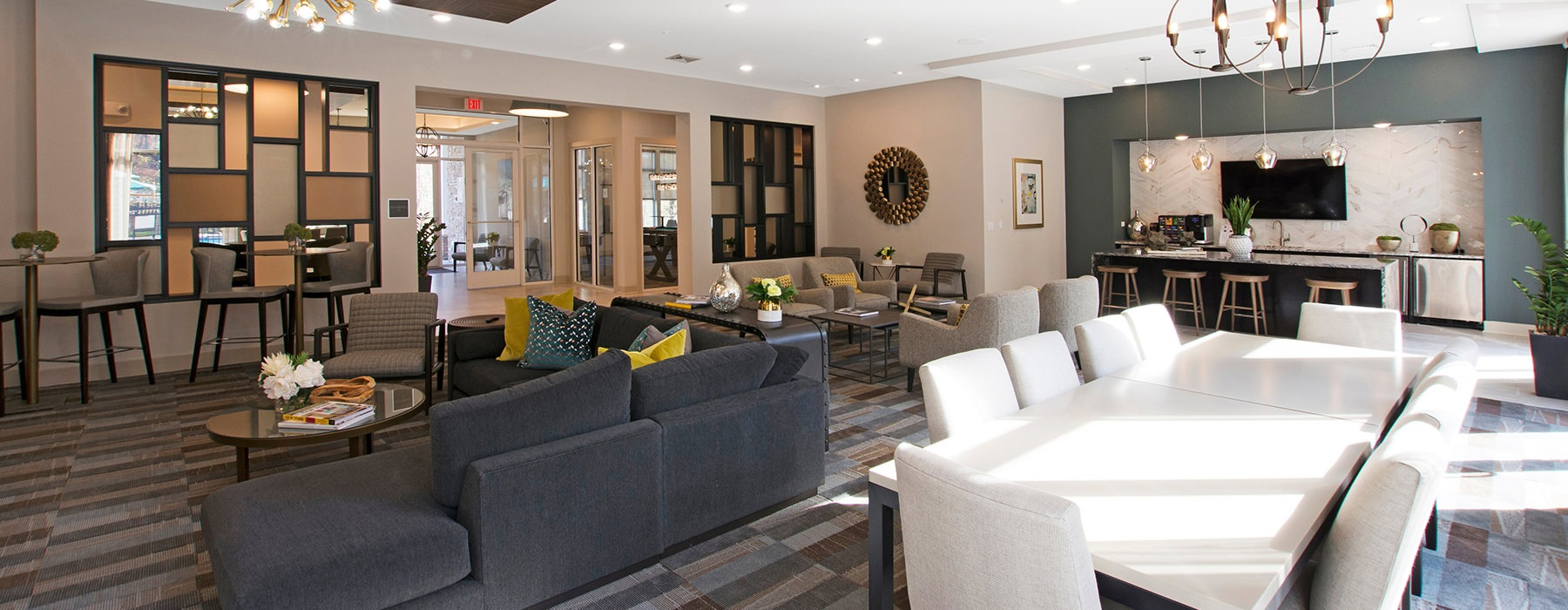 Clubhouse with a large table and lounge seating